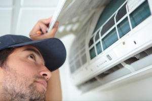 Sunshine Coast based Air Conditioning Installation expert reviewing filters of air con