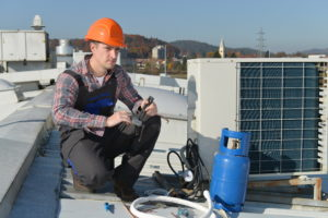 Perth-based air conditioning installation technician on roof