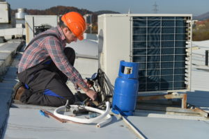 Air Conditioning Installation Gold Coast expert fixing compressor on roof